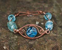 OOAK Blue eye copper lampwork wire wrapped bracelet on Etsy, $48.48 CAD
