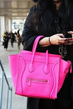 neon pink Celine mini luggage
