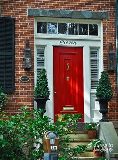 One possibility - Brick w/black shutters and red front door. Garage Door Colors, Door Paint Colors, Front Door Colors, Front Door Decor, Front Doors, Black Shutters, Windows And Doors, Red Doors, Red Bricks