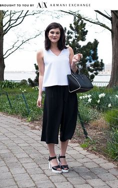 Culottes Outfit Ideas OOTD Tips   We're looking for some street-style inspiration to guide us in our quest to conquer the prettiest hybrid bottom of them all. #refinery29 http://www.refinery29.com/culottes-outfit-ideas