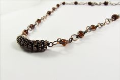 CopperJEWEL oxidized copper wire and glass bead necklace.