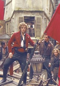 Aaronjolras: This is what rebellious barricade man looks like..watch and learn boys. Combeferre: I bow to your awesomeness. Marius: I am struck to the bone in a moment of breathless delight. Gavroche: Why did Marius dress like me today? First he stalks Cosette and now he steals my look. Total creeper. And why are there no cupcakes on this stupid barricade? <