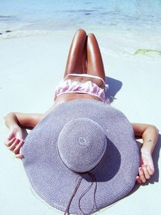 African Violet Beach Hat - Not only is the hat amazing but we wouldn't mind laying on a beach like that!!