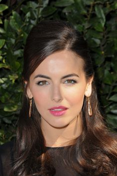 Camilla Belles long, brunette hairstyle