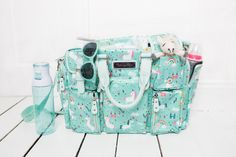 A diaper bag or nappy bag is a storage bag with many pocket-like spaces that is big enough to carry everything needed by someone taking care of a baby while taking a typical short outing. Baby Doll Diaper Bag, Cute Diaper Bags, Best Diaper Bag, Diaper Bag Backpack, Nappy Bags, Unicorn Baby Outfit, Baby Unicorn, Unicorn Baby Clothes, Diy Baby