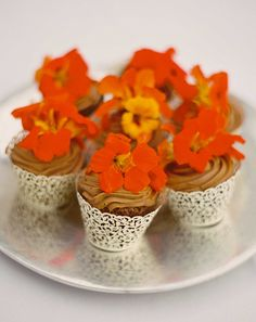 chocolate cupcakes with edible flowers on top