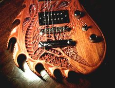 Wood carved Guitar