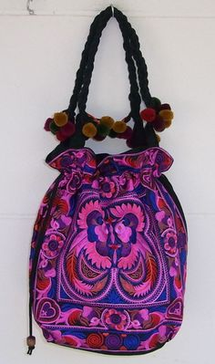 This beautiful Tote bag is hand made by the HMONG hill tribes of Northern Thailand (Lanna Country).. It features a zipper opening and an inside zippered pocket.CLOTH MADE BY HMONG HILL TRIBE - THAILANDHMONG tribes live in the North of Thailand and have origins from the Thibetean area of China. Their livelihood has changed from Opium farming to handcrafting.