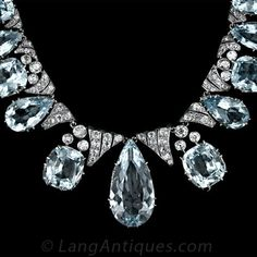 A rare and gorgeous, opulent and elegant, Victorian-era aquamarine and diamond necklace in silver over gold. A graduated array of pear-shape and cushion-shape aquamarines totaling approximately 150(!) carats are presented in regal style , circa 1890. In addition to the collection of aquas, the necklace contains 9.00 carats of old-mine cut and antique cushion-cut diamonds.