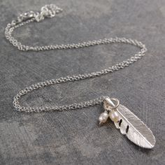This charming delicate sterling silver and freshwater pearl feather pendant is a staple piece for your everyday jewellery, with a beautiful and mystical twist! #Jewellery #feather #pearls #fresh