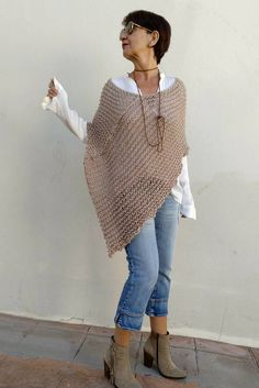 Knit wool poncho, women poncho, loose knit poncho. This knitted wool poncho is the perfect article to shelter and to adorn. You can use it as a chunky cowl (photo 4) or to leave it you to fall down on the shoulders and you will have two articles in one, for what more is it possible to ask?