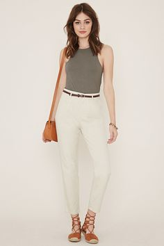 A pair of high-waisted woven pants with a straight-leg silhouette, a zip fly, two slanted front pockets, two back mock pockets, and a removable faux leather belt.