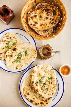 Homemade naan Indian blog ups all purpose flour or wheat flour 1/2 cup of warm milk 1/2 cup of yogurt 1/4 tsp salt 3/4 tsp baking powder 1/2 tsp baking soda 1/2 tbsp sugar  1/2 tbsp oil These are the ingredients for dough and then you can flavor your naan with all kinds of herbs. I made cumin naan, garlic naan, butter naan and some topped with cilantro greens. So this is up to you