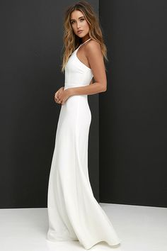 Impressively stylish, the Tour de Force Ivory Maxi Dress will show off your knack for elegant dressing! Adjustable spaghetti straps rise from a darted halter bodice and can be worn crossed or straight at back. Medium-weight woven fabric forms a fitted high waist, and full maxi skirt. Hidden back zipper with clasp.