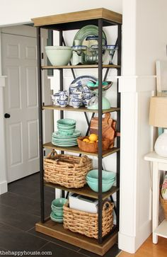 Think outside the box and use a beautiful etagere shelf for kitchen storage and display; or even for dish and glassware display in your dining room.