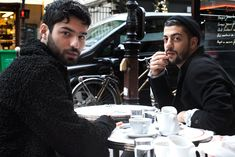 Stumbled on whilst browsing The Sartorialist, love the expressions made and how unmistakably Parisian these guys look, the black of their clothes set against the white china and tables.