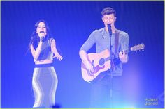 Camila Cabello & Shawn Mendes Continue Their Cuteness at Tampa Jingle Ball 2015: Photo #908125. Camila Cabello gives Shawn Mendes a sweet hug on stage during 93.3 FLZ's Jingle Ball 2015 held at Amalie Arena on Saturday night (December 19) in Tampa Bay, Fla.…