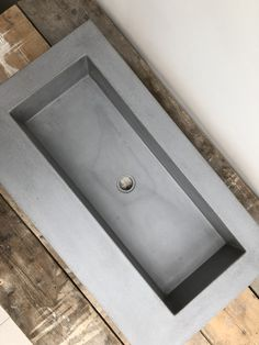 Polished concrete trough sink basin in true concrete grey ideal for bathroom restaurant utility bar made by concrete Tuesdays.