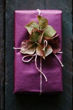 We love the rich plum color of the gift wrap here - it really brings out the undertones in the hydrangeas!