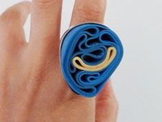 Patrizia Iacino   Patrizia Iacino has developped a line of rings and necklaces made from recycled rubber bands which her friends collect from the vegetables, with a base in 925 sterling silver