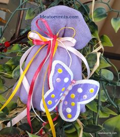 Christening pouch in lilac pouch with ribbons and hand-painted butterfly! Μπομπονιέρα βάπτισης λιλά πουγκάκι με κορδέλες και χειροποίητη πεταλούδα ζωγραφική. Code N° MB0111   Ideatoevents.com