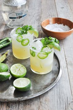 Fresh Lime & Jalapeno Margarita 1/2 cup fresh-squeezed lime juice (no exceptions!) 1/2 large green jalapeno pepper, sliced thin 4 ounces silver tequila  2 ounces honey 2 tablespoons sea salt 2 lime wedges for garnish 2 sprigs cilantro for garnish (optional)