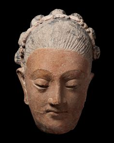 """Head of a woman   Greater Gandhara region  4th / 5th century  Unfired clay and pigment  Height : 23cm (9.06"""")"""