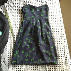 REDUCED Juicy Couture Navy Blue Dress Green Bows Beautiful navy blue adjustable spaghetti strap dress with green bows all over. Scalloped hem.. Size 2 fits like a 4. Sheer chiffon overlay.   Really cute dress. NWT Juicy Couture Dresses