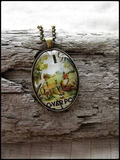 One-of-a-kind jewelry made from used and vintage postage stamps!    Postage Stamp Pendant  The Fox & The Stork by OhThePost on Etsy, $30.00