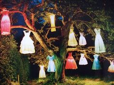 Ghostly Gathering...old wedding dresses and patio lanterns make a cool display