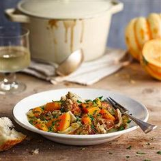 Chicken, sausage and squash stew recipe. Celebrate the flavours of autumn with this chicken, sausage and squash stew. It's a warming recipe for when the chill sets in.
