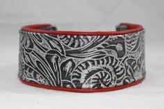 Black tooled leather with red lining leather. Martingale collar by Collar Addict.
