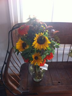 Cutting sunflowers just as the petals start unfurling allows them to last longer in the vase.