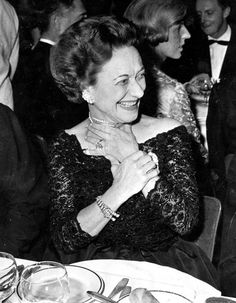 The Duchess of Windsor wearing the Cartier tiger jewels at the Gala opening of the Lido Revue in Paris, 11 December 1959