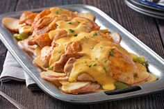 While you're out and about, these chicken thighs and cheesy potatoes will be simmering away, getting more tender and flavorful in the slow cooker.