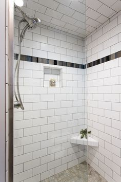 Shower Walls: 4x8 Gloss Biscuit Subway; Floor: Rox color Dust; Accent: Manhattan Stone & Glass Mosaic in Color Skyline; Shower Door: Brushed Nickel Clear Glass