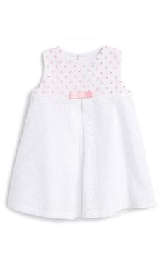 Free shipping and returns on Luli & Me Sleeveless Eyelet Dress (Baby Girls) at Nordstrom.com. A charming eyelet overlay embellishes a pretty little dress fashioned with a lovely center pleat and bow-topped bodice peppered with tiny pink accents.