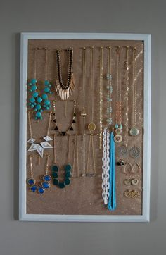 DIY jewelry holder..huge cork board + sparkly tulle +gold push pins. this is perfect!