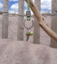 Green Suede Cord Wisdom Necklace with Acai and Abalone Beads and a Feather Charm on Etsy, $24.99
