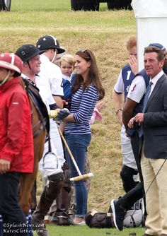 Kate holds Prince George while she chats with husband Prince William during a break at the Festival of Polo. via Kate's Clothes (www.katesclothes.com) #KateMiddleton #DuchessKate