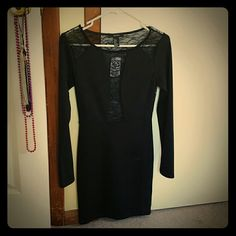 NEVER WORN Black Dress Forever 21 black, long sleeve dress. Perfect for a fun night out / club setting.  Size small.   The back of the dress is completely lace as well as tops of the shoulders and mid section of the chest.   Tags are still on the dress. Dress was never worn! I bought this item online in hopes to wear it out for NYE. It unfortunately did not fit and the store would not let me return it. (Everyone should just stop shopping at Forever 21 in general) Forever 21 Dresses Mini