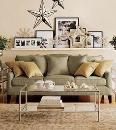 Love the sofa and the assortment of pics on the shelf above w/ stars.  Not a fan of the coffee table.