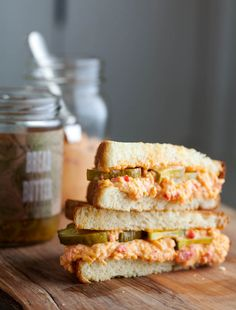 Blackberry Farm Pimento Cheese Recipe | this looks amazing. Garlic, hot sauce, dill pickle brine - more flavor than your mama's pimiento cheese :)