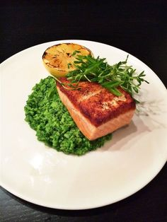 Salmon with mashed peas and pea shoot salad
