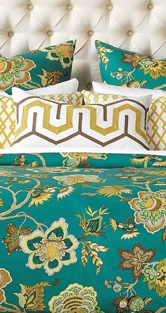 The McQueen Bedding Collection is the perfect way to brighten up any bedroom. Expertly detailed flowers, leaves, and vines scroll throughout the teal background, while pillows featuring golden tones pull the entire look together.