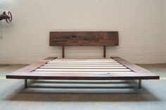 A modern bed frame made out of solid American Black Walnut from responsibly sourced trees in Pennsylvania. Made by hand, this bed is meticulously