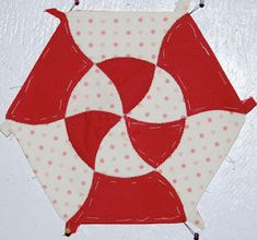 Barbara Brackman's MATERIAL CULTURE, Lily Quilts did a similar Hexalong in 2011. See her tutorial on drawing and piecing curved seams at this post:  http://lilysquilts.blogspot.com/2011/07/hexalong-curved-seams.html