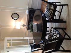 Black and white dining room.  Vintage table and chairs using modern fabric on the seats