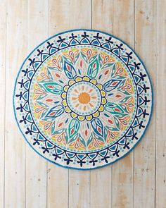 Inspired by antique rugs and ancient mandala (sacred symbols representing the universe), this hand hooked rug brings a meditative ambience into your own home.