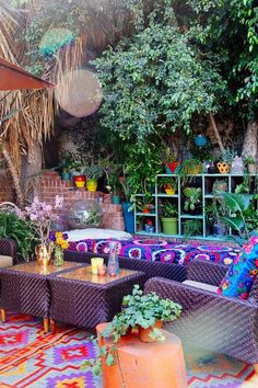 The combination of bright colors and bold prints paired with an abundance of plants turns this outdoor space into the ultimate Zen hangout.